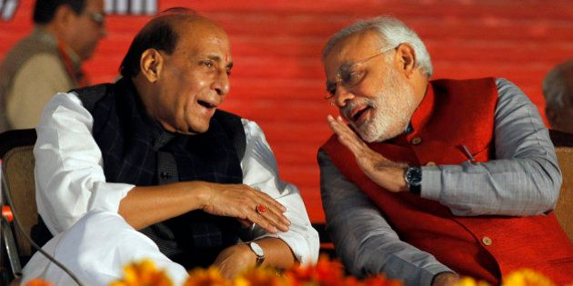 India's main opposition Bharatiya Janata Party (BJP) prime ministerial candidate Narendra Modi, right,...