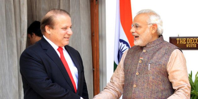 NEW DELHI, INDIA - MAY 27: Indian Prime Minister Narendra Modi (L) shakes hand with his Pakistani counterpart...