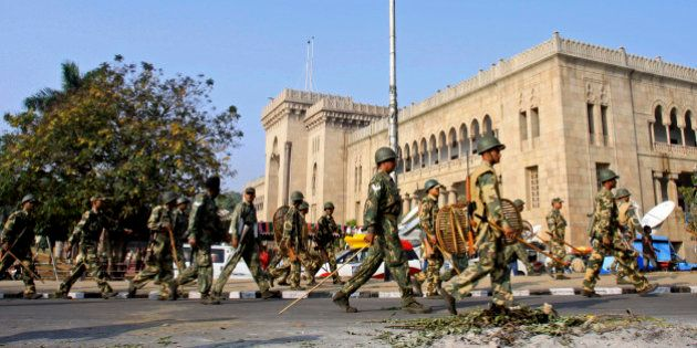 Police march past in Osmania University campus during a strike in Hyderabad, India, Monday, Dec. 7, 2009....