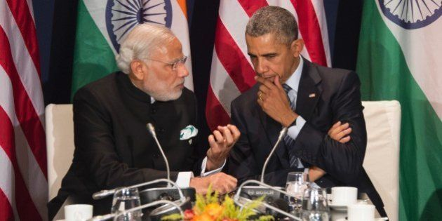 US President Barack Obama (R) talks with Indian Prime Minister Narendra Modi during a meeting at the...
