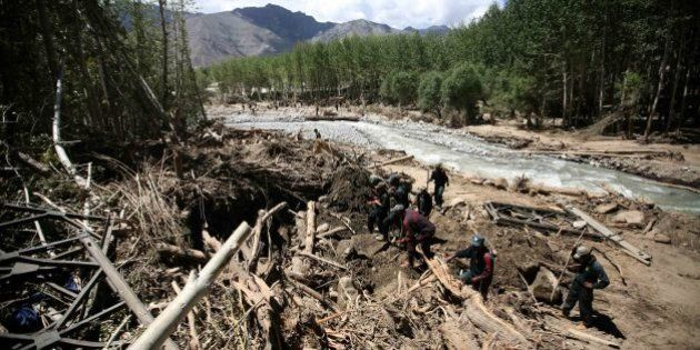 LEH, INDIA � AUGUST 10 : Rescue team looking for dead bodies near Phyang village in Leh. Flash floods...
