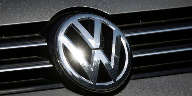 A Volkswagen AG badge sits on a car displayed on the forecourt of a dealership in London, U.K., on Wednesday,...