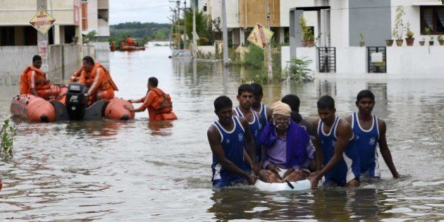 National Disaster Response Force (NDRF) rescue flood affected people during their relief operations in...