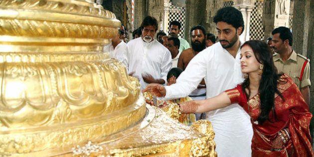 Tirupati, INDIA: Indian actors Abhishek Bachchan (2R) and Aishwarya Rai (R) are watched by Amitabh Bachchan...