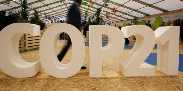 FILE - In this Dec. 1, 2015 file photo, a man visits the Climate Generations Areas, part of the COP21,...