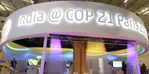 Visitors walk at the information booth of India during the COP 21 United Nations conference on climate...