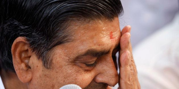 Congress party leader Jagdish Tytler reacts as he holds a press conference to announce his decision to...