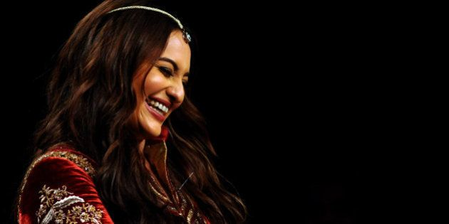 Indian Bollywood actress Sonakshi Sinha showcases a creation by designer JJ Valaya during the Blenders...