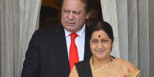 NEW DELHI, INDIA MAY 27: Pakistan Prime Minister Nawaz Sharif and External Affairs Minister Sushma Swaraj...