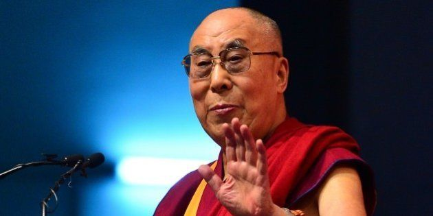 Tibetan spiritual leader, The Dalai Lama gestures as he addresses the gathering during the foundation...