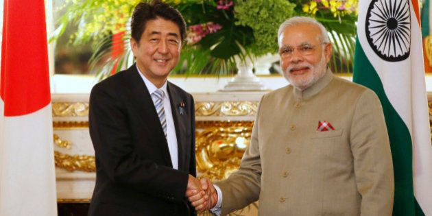 India's Prime Minister Narendra Modi, right, and Japan's Prime Minister Shinzo Abe shake hands before...