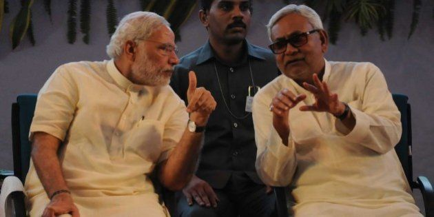 PATNA, INDIA - JULY 25: Prime Minister Narendra Modi interacts with Bihar Chief Minister Nitish Kumar...