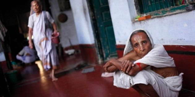 An Indian widow rests inside a religious retreat in Vrindavan, India, Friday, Sept. 6, 2013. Widows in...