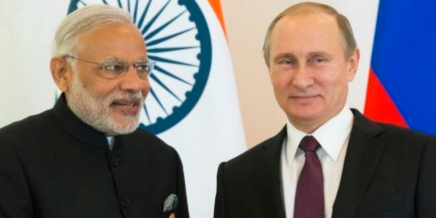 Russian President Vladimir Putin, right, and Indian Prime Minister Narendra Modi pose for photo during...