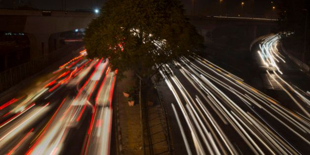 In this Dec 1, 2015 photo, streaks of light show traffic moving in New Delhi, India. Over the last decade...