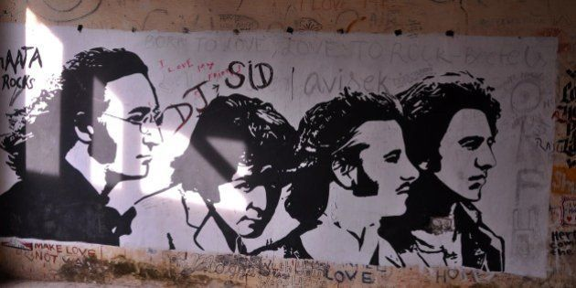 This photograph taken on December 8, 2015 shows graffiti painted on the walls of a hall at the Beatles...