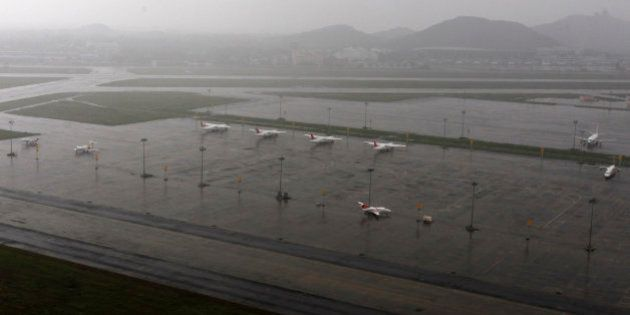 Aircrafts are seen parked in the waterlogged airport after heavy rainfall in Chennai, India, Saturday,...