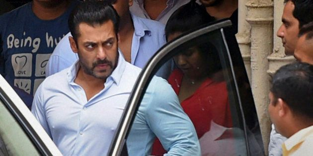 INDIA OUT - Bollywood actor Salman Khan leaves home for court in Mumbai, India, Friday, May 8, 2015....