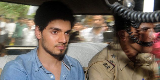 Indian actor Suraj Pancholi, boyfriend of the late Bollywood film actress Jiah Khan, sits inside a police...