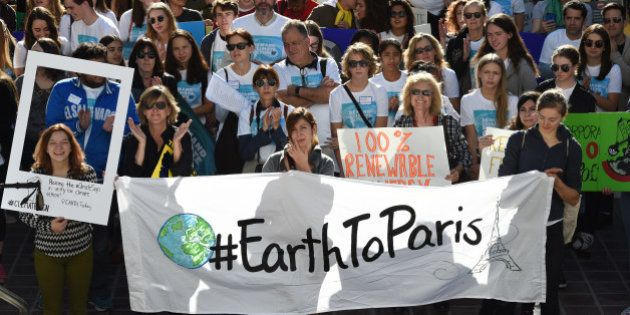 Environmental activists and supporters during a rally calling for action on climate change in Los Angeles,...