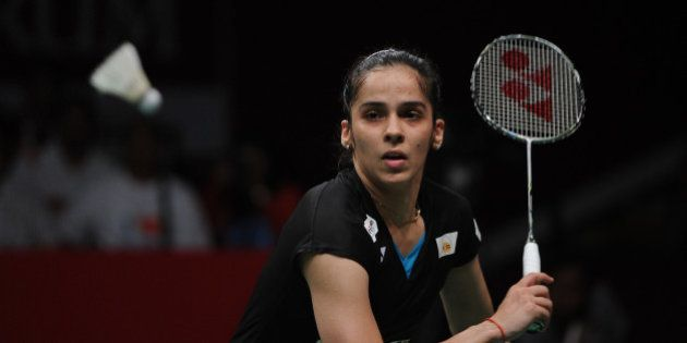 JAKARTA, INDONESIA - AUGUST 16: Saina Nehwal of India competes against Carolina Marin of Spain in the...