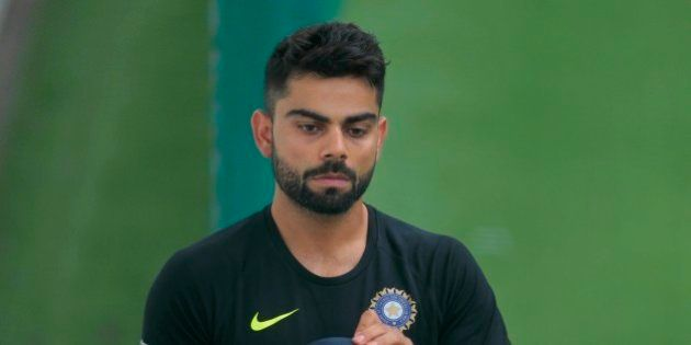 Indian cricket captain Virat Kohli, gets ready to bat during an indoor practice session in Colombo, Sri...