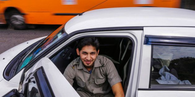Sujas Kumar Singh, a driver for the Uber Technologies Inc. ride-hailing service, poses for a photograph...