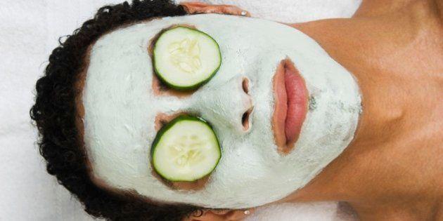 Mixed Race man receiving spa facial