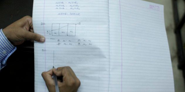 In this Thursday, Aug. 5, 2010 photograph, students copy what the teacher writes on the board at a cram...