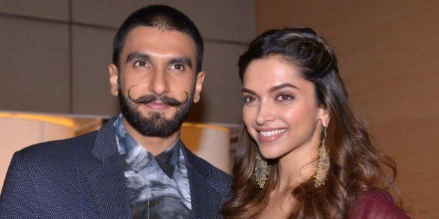 Indian Bollywood actor Ranveer Singh (L) and actress Deepika Padukone pose during a promotional event...