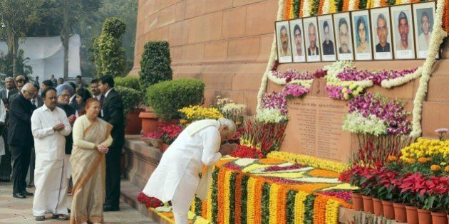 Indian Prime Minister Narendra Modi (R) pays his respects on the 13th anniversary of the 2001 attack...