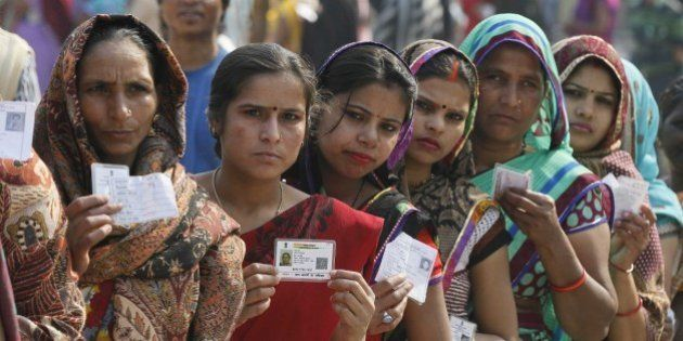 NEW DELHI, INDIA - FEBRUARY 7: Women in queue to cast their vote at Tughlakabad polling station, during...