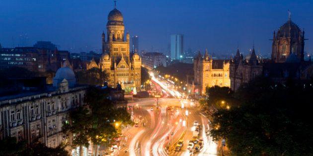 View over Victoria terminus or Chhatrapati Shivaji terminus (CST) and central Mumbai at dusk Mumbai