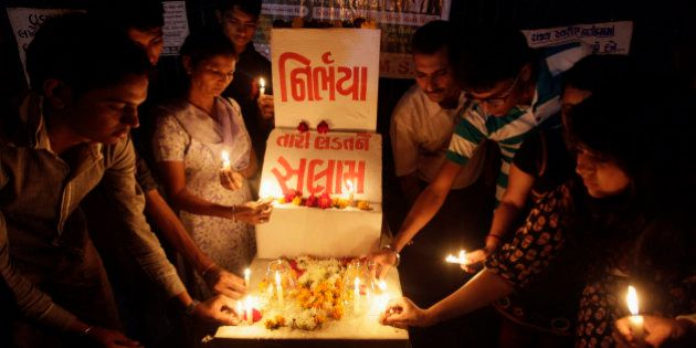 Indians place candles as they remember last year's gang rape and murder of a young woman in New Delhi,...