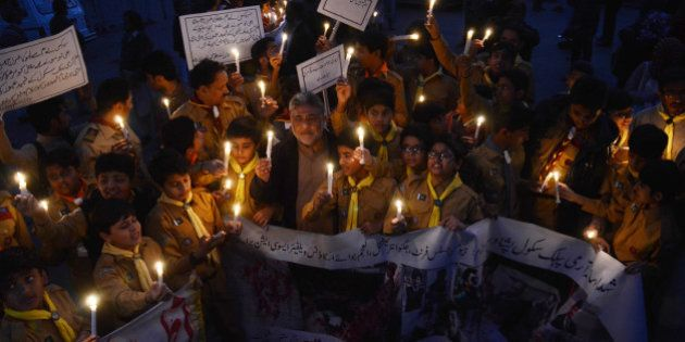 LAHORE, PUNJAB, PAKISTAN - 2015/12/15: Pakistani students,teachers and civil society activists hold lit...