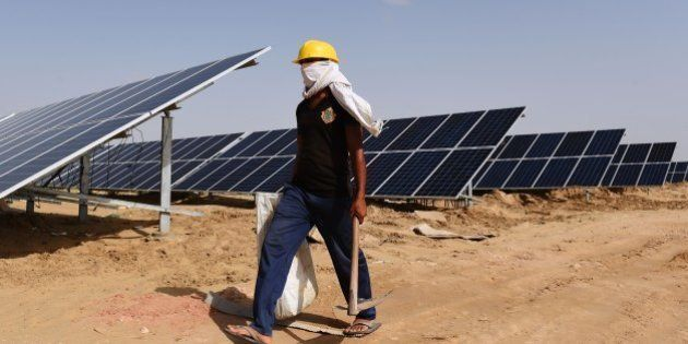 TO GO WITH: Climate-warming-COP21-India-energy-solar, FOCUS by Annie Banerji In this photograph taken...