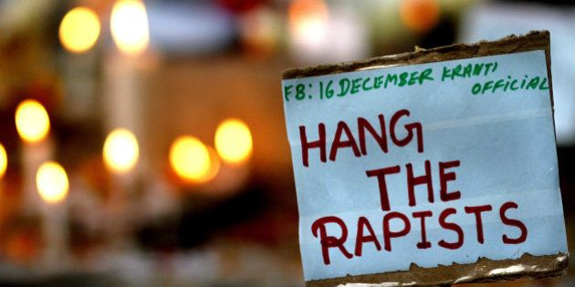 NEW DELHI, INDIA - DECEMBER 16: A placard calling for capital punishment for rapists is pictured beside...