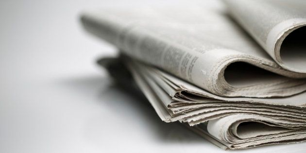 newspapers against plain background shot with very shallow depth of