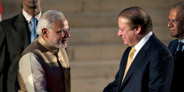 India's new prime minister Narendra Modi, left, shakes hands with his Pakistani counterpart Nawaz Sharif,...