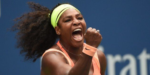 Serena Williams of the US celebrates winning a point against Roberta Vinci of Italy during their 2015...