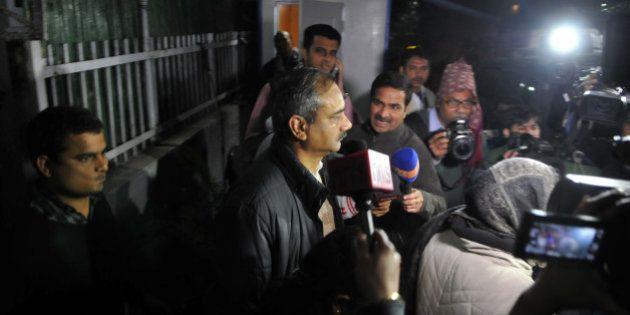 NEW DELHI, INDIA - DECEMBER 15: CBI team taking Rajendra Kumar Gupta for questioning during the raid...