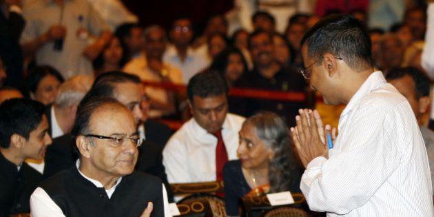 NEW DELHI, INDIA - APRIL 8: Delhi Chief Minister Arvind Kejriwal greets Union Finance minister Arun Jaitley...