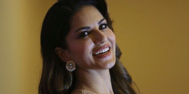Bollywood star Sunny Leone poses after a press conference to promote her upcoming