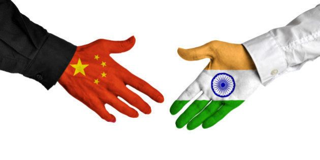 Diplomatic handshake between leaders from China and India with flag-painted