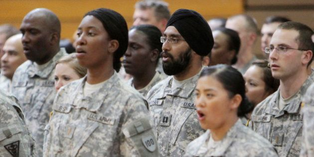FILE - In this Monday, March 22, 2010 photo, U.S. Army Capt. Tejdeep Singh Rattan, center wearing turban,...