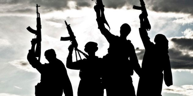 Silhouette of several muslim militants with