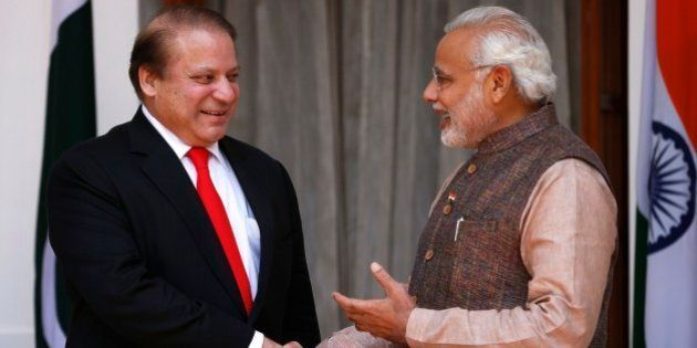 Indian Prime Minister Narendra Modi, right, shakes hand with his Pakistani counterpart Nawaz Sharif before...