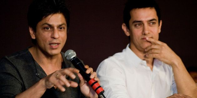 BOMBAY, INDIA - APRIL 07: Bollywood superstars Shah Rukh Khan and Aamir Khan takes part in discussions...
