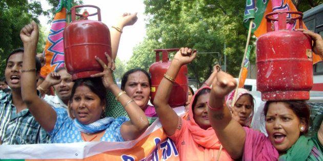 NEW DELHI, INDIA - OCTOBER 12: BJP Mahila Morcha activists carry LPG cylinders during a protest against...