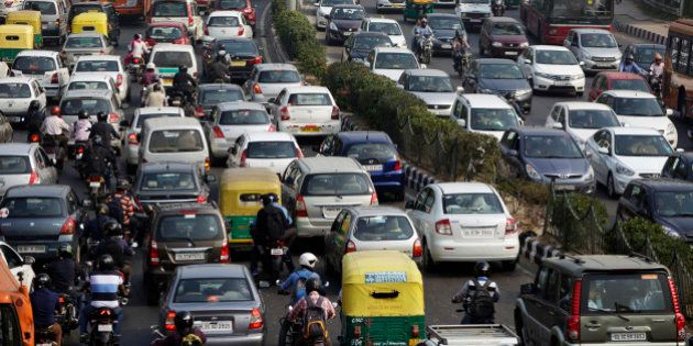 Traffic moves along a highway during morning rush hour in Delhi, India, on Oct 29, 2015. India in October...